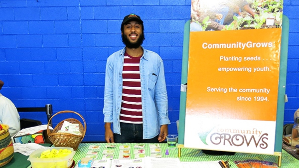 Photo of Jay tabling for CommunityGrows at a neighborhood event