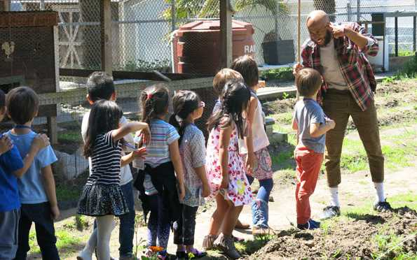 Photo of Jay teaching a gardening class